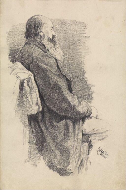 Eldre sittende mann i profil