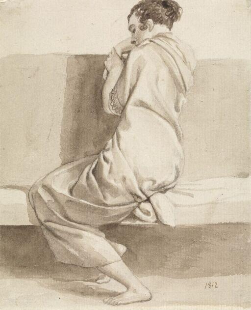 Sittende kvinne