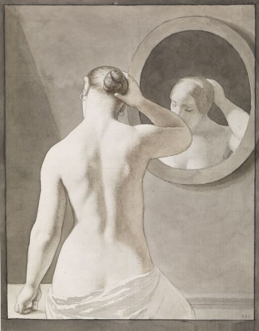 Ung kvinne foran et speil