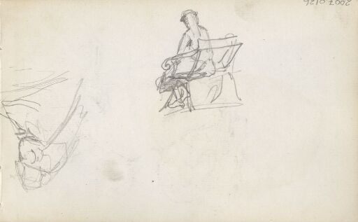 Mann sittende på benk