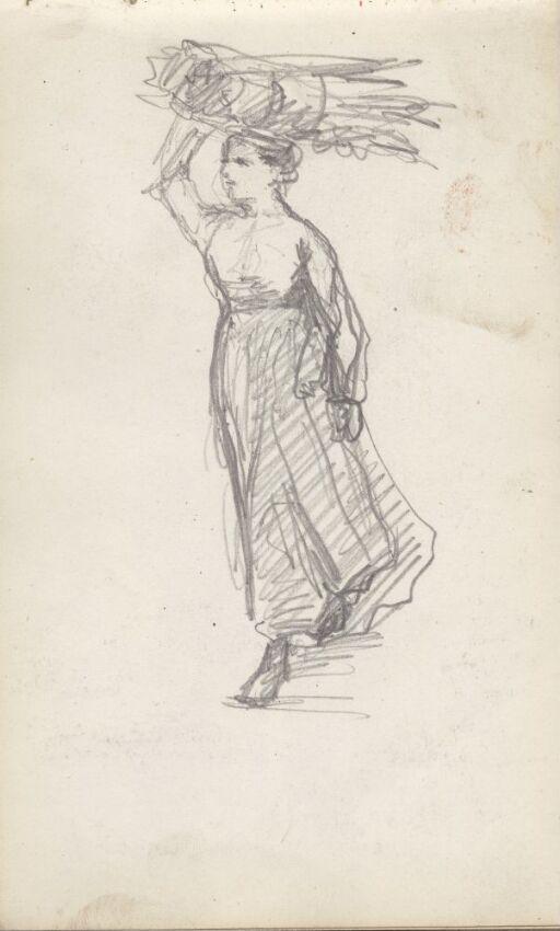 Kvinne som bærer kornstakk på hodet