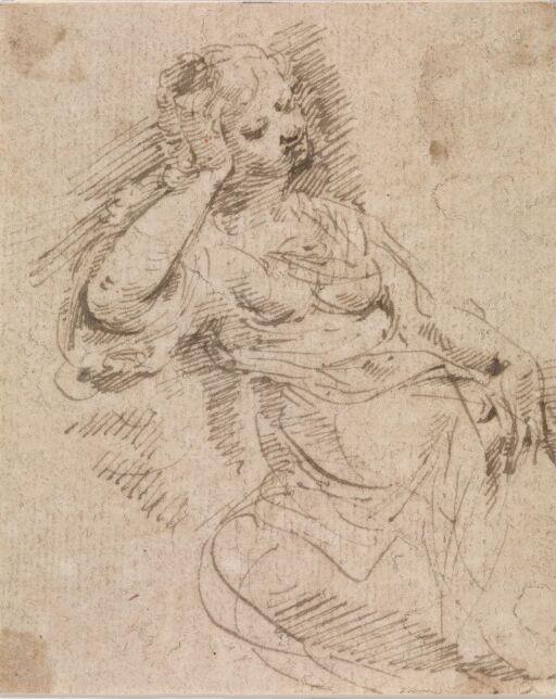 Kvinne som støtter hodet i hånden