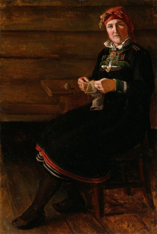 Sittende kvinne i Setesdals-bunad