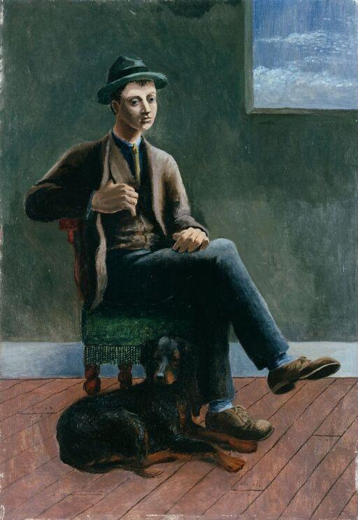 Ung mann med en hund