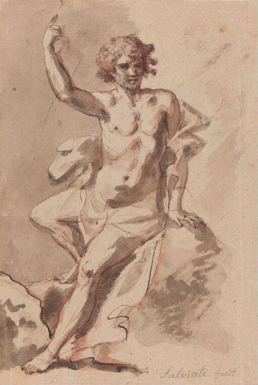 Sittende naken ung mann som peker mot himmelen