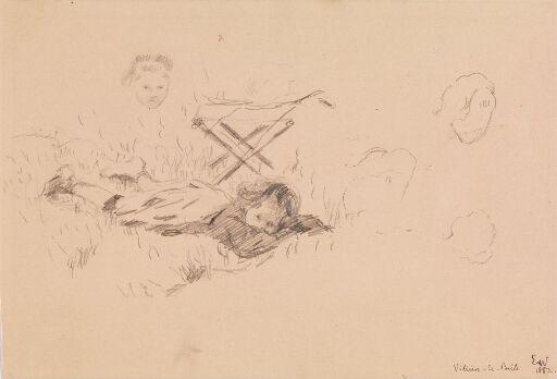 Gutt som ligger i gresset