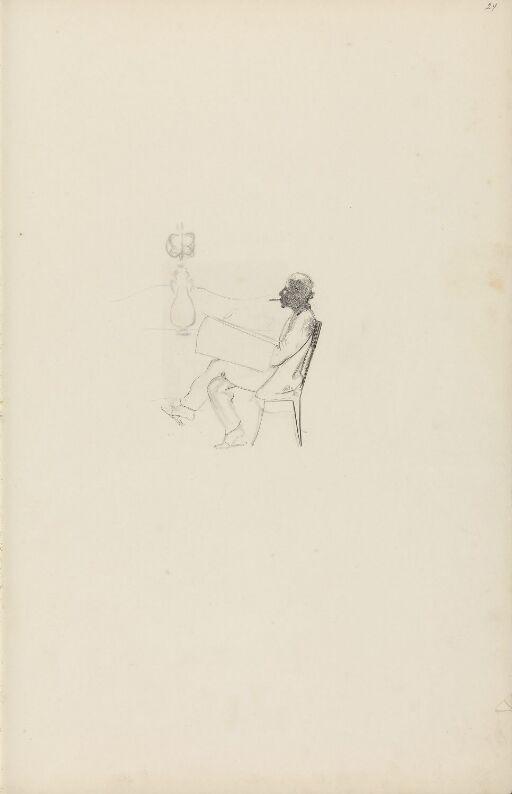 Figur sittende på en stol
