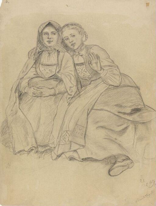 To sittende bunadskledde jenter