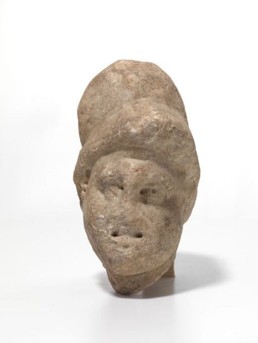 Helmeted head from sarcophagus relief